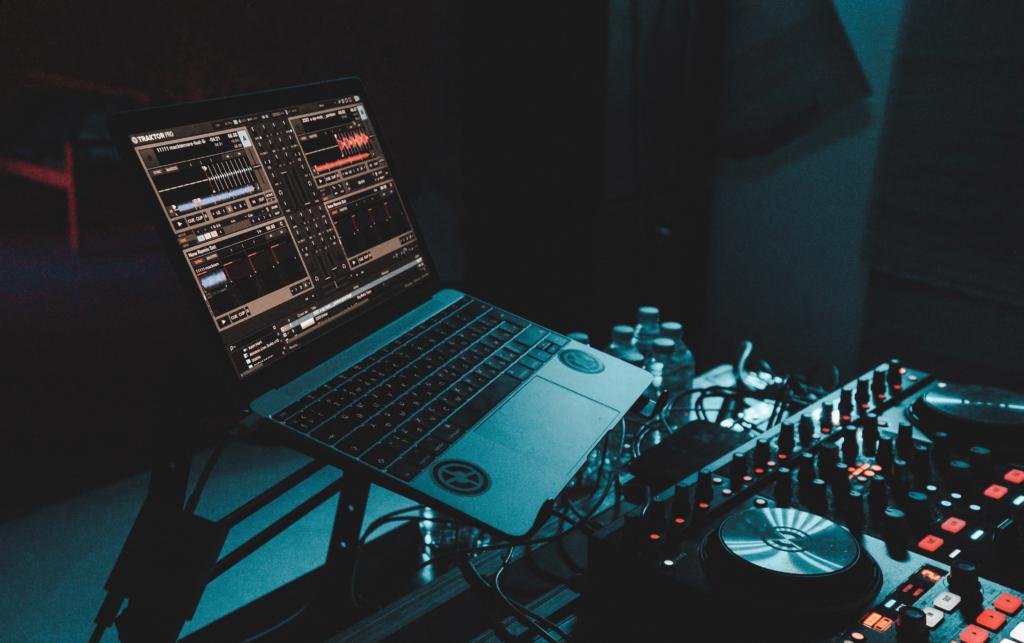 Macbook Computer running Traktor with DJ Decks